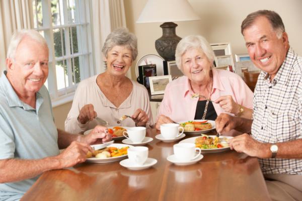 Seniors group eating