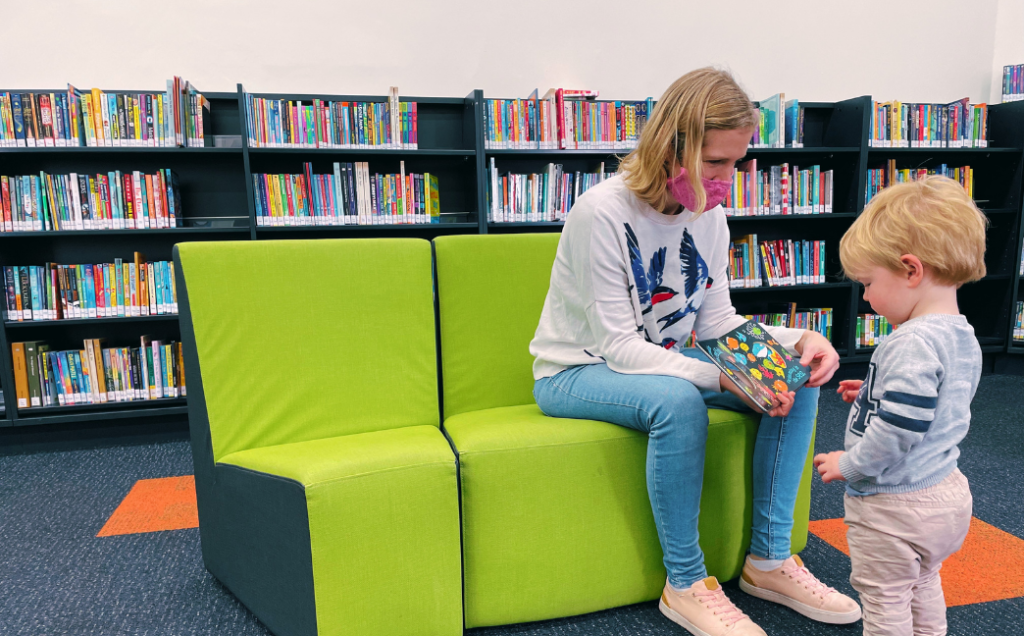 Cr Katrina Hodgson with her son Joe at Ascot Vale Library reading a story book together.