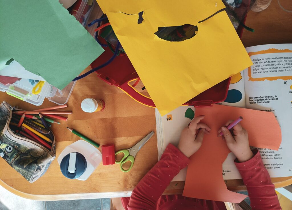 child playing crafts